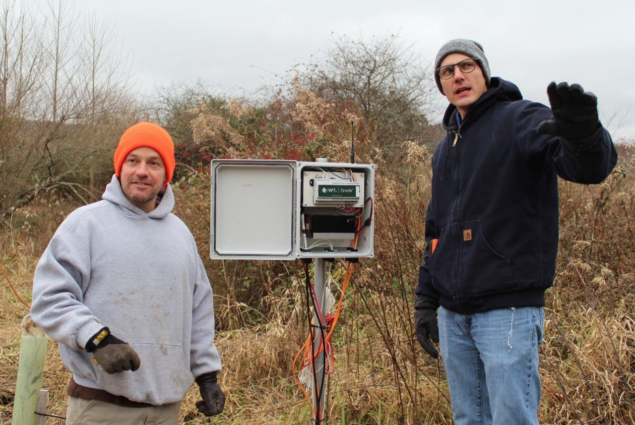 Daniel McLaughlin, left, and Matthew Fisher discuss the 1 kilometer distance for communication between the environmental sensing system's node network and gateway