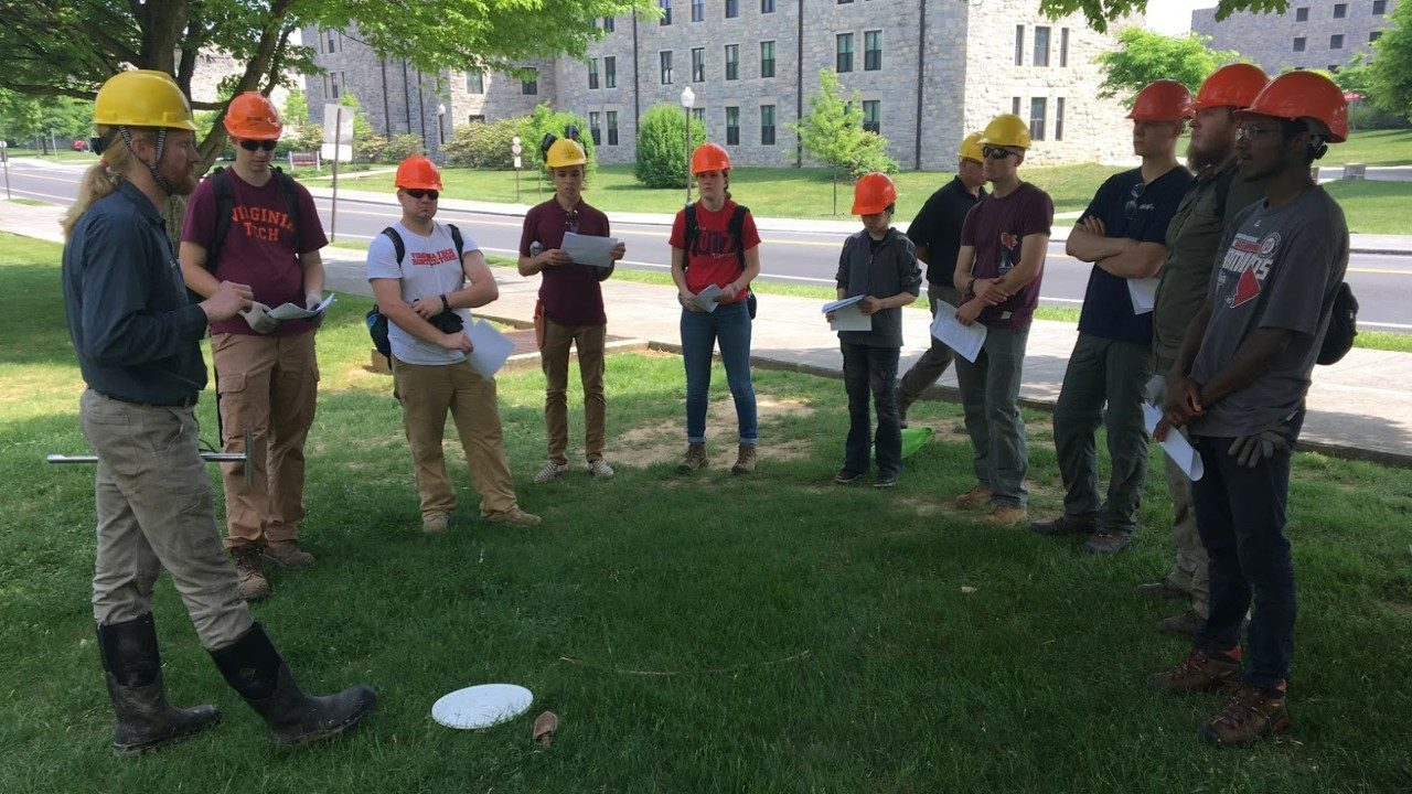 Dr. Chris Fields-Johnson (B.S. Forestry, 2008, M.S. CSES, 2011, Ph.D. CSES, 2016) in the yellow hardhat at left discusses soil fertility diagnostics and management with students in the Arboriculture Field Skills course during May 2018. Chris, a technical advisor with Davey Tree Experts, is one of several professional arborists who volunteer as guest instructors for this week-long course in which students learn how to care for trees in the urban forest.